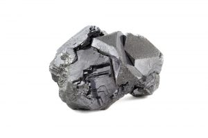 A lump of pure lead ore on a white background